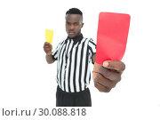 Купить «Serious referee showing yellow and red card», фото № 30088818, снято 24 апреля 2014 г. (c) Wavebreak Media / Фотобанк Лори