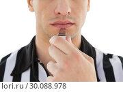 Купить «Mid section of referee blowing whistle», фото № 30088978, снято 24 апреля 2014 г. (c) Wavebreak Media / Фотобанк Лори
