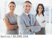 Купить «Businessman smiling with folded arms », фото № 30090334, снято 6 мая 2014 г. (c) Wavebreak Media / Фотобанк Лори
