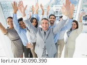 Купить «Cheering workers with raised arms», фото № 30090390, снято 6 мая 2014 г. (c) Wavebreak Media / Фотобанк Лори
