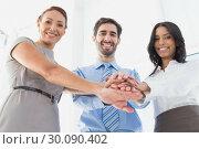 Купить «Workers with stacked hands smiling», фото № 30090402, снято 6 мая 2014 г. (c) Wavebreak Media / Фотобанк Лори