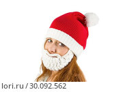 Купить «Pretty redhead in santa hat and beard», фото № 30092562, снято 2 июля 2014 г. (c) Wavebreak Media / Фотобанк Лори