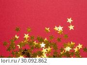 Купить «Golden star decorations spread out», фото № 30092862, снято 16 июля 2014 г. (c) Wavebreak Media / Фотобанк Лори