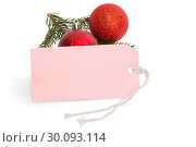 Купить «Pink tag with christmas decorations», фото № 30093114, снято 18 июля 2014 г. (c) Wavebreak Media / Фотобанк Лори