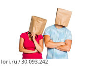 Young couple with bags over heads. Стоковое фото, агентство Wavebreak Media / Фотобанк Лори