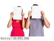 Купить «Couple covering faces with paper», фото № 30093306, снято 2 июля 2014 г. (c) Wavebreak Media / Фотобанк Лори