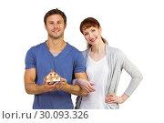 Купить «Couple holding a model house», фото № 30093326, снято 4 июля 2014 г. (c) Wavebreak Media / Фотобанк Лори