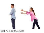 Woman trying to hug man. Стоковое фото, агентство Wavebreak Media / Фотобанк Лори