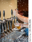 Купить «Composite image of barman pulling a pint of beer», фото № 30096006, снято 29 августа 2014 г. (c) Wavebreak Media / Фотобанк Лори