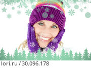 Composite image of radiant young woman with cap and gloves in the winter. Стоковое фото, агентство Wavebreak Media / Фотобанк Лори