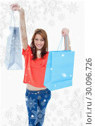 Composite image of teenage girl smiling and raising her shopping bags in the air. Стоковое фото, агентство Wavebreak Media / Фотобанк Лори