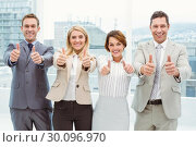 Купить «Business people gesturing thumbs up in office», фото № 30096970, снято 8 мая 2014 г. (c) Wavebreak Media / Фотобанк Лори