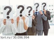 Купить «Business people holding question mark signs in office», фото № 30096994, снято 8 мая 2014 г. (c) Wavebreak Media / Фотобанк Лори