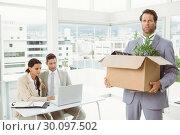 Купить «Businessman carrying his belongings in box», фото № 30097502, снято 8 мая 2014 г. (c) Wavebreak Media / Фотобанк Лори