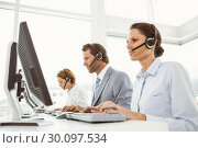 Купить «Business people with headsets using computers in office», фото № 30097534, снято 8 мая 2014 г. (c) Wavebreak Media / Фотобанк Лори