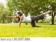 Купить «Brunette in balance pose on grass», фото № 30097886, снято 20 июня 2014 г. (c) Wavebreak Media / Фотобанк Лори