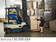 Купить «Warehouse manager checking her inventory», фото № 30099654, снято 6 сентября 2014 г. (c) Wavebreak Media / Фотобанк Лори