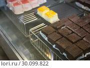 Купить «Close up of brownies and slices of cheesecake», фото № 30099822, снято 7 сентября 2014 г. (c) Wavebreak Media / Фотобанк Лори