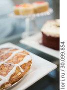 Купить «Close up of icing pie and sweet desert», фото № 30099854, снято 7 сентября 2014 г. (c) Wavebreak Media / Фотобанк Лори