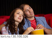 Young couple watching a film. Стоковое фото, агентство Wavebreak Media / Фотобанк Лори
