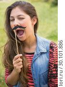 Купить «Pretty brunette with fake mustache», фото № 30101886, снято 11 ноября 2014 г. (c) Wavebreak Media / Фотобанк Лори