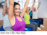 Купить «People sitting on exercise balls in fitness class», фото № 30102502, снято 13 ноября 2014 г. (c) Wavebreak Media / Фотобанк Лори