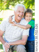 Купить «Happy grand father with his grandson », фото № 30102626, снято 17 ноября 2014 г. (c) Wavebreak Media / Фотобанк Лори