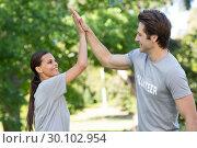 Купить «Happy volunteer couple high fiving », фото № 30102954, снято 17 ноября 2014 г. (c) Wavebreak Media / Фотобанк Лори