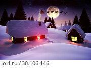 Santa flying over village at night. Стоковое фото, агентство Wavebreak Media / Фотобанк Лори