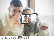 Купить «Couple taking selfie on smartphone», фото № 30106598, снято 19 января 2015 г. (c) Wavebreak Media / Фотобанк Лори