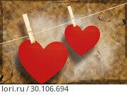 Купить «Composite image of hearts hanging on a line», фото № 30106694, снято 19 января 2015 г. (c) Wavebreak Media / Фотобанк Лори