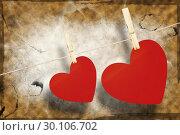 Купить «Composite image of hearts hanging on a line», фото № 30106702, снято 19 января 2015 г. (c) Wavebreak Media / Фотобанк Лори