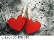 Купить «Composite image of hearts hanging on line», фото № 30106710, снято 19 января 2015 г. (c) Wavebreak Media / Фотобанк Лори
