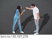 Composite image of angry couple shouting at each other. Стоковое фото, агентство Wavebreak Media / Фотобанк Лори