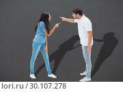 Купить «Composite image of angry couple shouting at each other», фото № 30107278, снято 19 января 2015 г. (c) Wavebreak Media / Фотобанк Лори