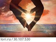Купить «Composite image of close up of hands forming heart», фото № 30107530, снято 19 января 2015 г. (c) Wavebreak Media / Фотобанк Лори