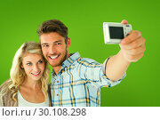 Купить «Composite image of attractive couple taking a selfie together», фото № 30108298, снято 21 января 2015 г. (c) Wavebreak Media / Фотобанк Лори