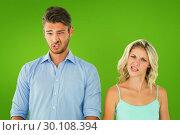 Купить «Composite image of young couple making silly faces», фото № 30108394, снято 21 января 2015 г. (c) Wavebreak Media / Фотобанк Лори