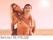 Купить «Laughing man giving his pretty girlfriend a piggy back smiling », фото № 30110226, снято 3 апреля 2013 г. (c) Wavebreak Media / Фотобанк Лори