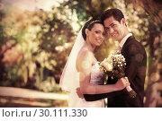 Купить «Loving newly wed couple in garden», фото № 30111330, снято 21 ноября 2013 г. (c) Wavebreak Media / Фотобанк Лори