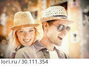 Купить «Hip young couple spending time together», фото № 30111354, снято 19 февраля 2014 г. (c) Wavebreak Media / Фотобанк Лори