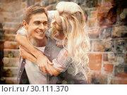 Купить «Man giving his pretty girlfriend a piggy back», фото № 30111370, снято 19 февраля 2014 г. (c) Wavebreak Media / Фотобанк Лори