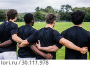 Rugby players standing together before match. Стоковое фото, агентство Wavebreak Media / Фотобанк Лори