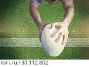 Купить «Composite image of rugby player ready to tackle the opponent», фото № 30112802, снято 17 сентября 2015 г. (c) Wavebreak Media / Фотобанк Лори