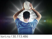Купить «Composite image of rugby player about to throw a rugby ball», фото № 30113486, снято 17 сентября 2015 г. (c) Wavebreak Media / Фотобанк Лори