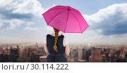 Купить «Composite image of pretty redhead businesswoman holding umbrella», фото № 30114222, снято 5 февраля 2016 г. (c) Wavebreak Media / Фотобанк Лори