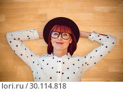 Composite image of attractive hipster woman lying on the floor . Стоковое фото, агентство Wavebreak Media / Фотобанк Лори