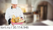 Купить «Composite image of friendly chef holding a bread basket », фото № 30114946, снято 27 апреля 2016 г. (c) Wavebreak Media / Фотобанк Лори