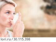 Купить «Composite image of blonde woman taking her inhaler», фото № 30115398, снято 27 апреля 2016 г. (c) Wavebreak Media / Фотобанк Лори