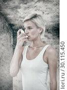 Купить «Composite image of blonde woman taking her inhaler», фото № 30115450, снято 27 апреля 2016 г. (c) Wavebreak Media / Фотобанк Лори